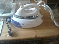 Steam generator iron with stand.