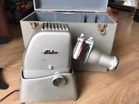 Vintage slide projector with film in pots
