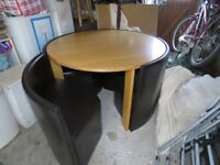 Round stowaway leather and oak table
