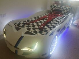New white car bed with lights and sounds free delivery
