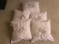 Five clean cream and embroidery scatter cushions
