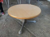 round wooden coffee table with metal legs