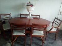 Extending dining table and 6 chairs used condition