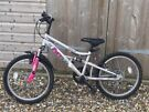 """Apollo Pure FS Girls Mountain Bike with 20"""" wheel, 11"""" frame for ages 7 to 10."""