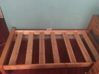 Free Single bed frame. Good solid wood. Used so a few scratches. Still in beautiful good condition.