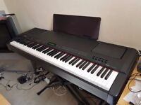 Yamaha P-250 electronic piano (with keyboard stand, music rest, FC4 sustain pedal, and manuals)