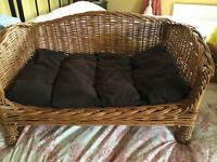 Lovely raised wicker pet bed, hardly used.