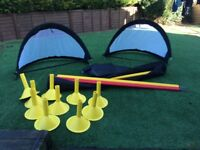 10 football training poles with bases and pop up goals.