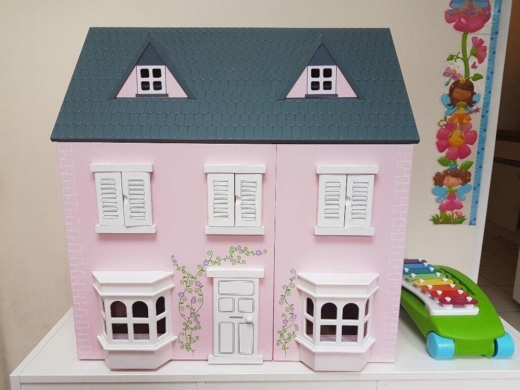 Beautiful wooden pink dolls house