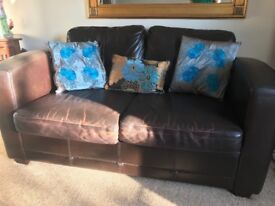 Two comfy brown leather sofa