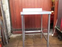 Stainless steel catering bench with upstand