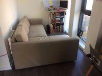 Corner sofa/double bed with storage