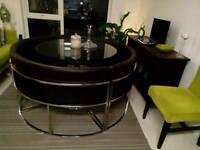 Designer circular space saver dining table