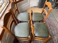 8 x Newly upholstered olive green leather and wooden chairs