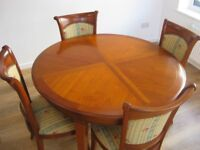 Dining Table as new condition with four chairs