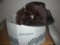 Hat in Brown, with bow for sale.One size.
