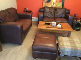 Leather 2 seater armchairs x 2 and storage footstool