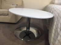 White oval coffee table with chrome stand. In perfect condition