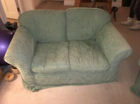 Three piece suite - 2 seater sofas X2, armchair x1; spare set of covers included