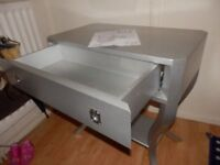 small partely woden table ( silver) with one drawer and silent system in very good condition