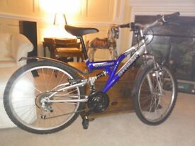 "Barracuda Tremor mountain bike. Full suspension. 14"" 36cm frame. 24"" wheels. 21 speed/gears."