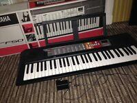 Yamaha psr f50 keyboard! With box book stand and mains adapter.