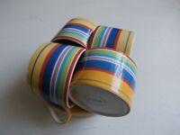 4 Decorative Cups & Saucers.