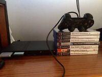 Playstation 2 slim black & 16 games