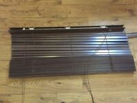 Dark wood venetian blind with header plinth and brackets, good condition