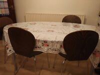Oval glass Dinning table with 5 chairs