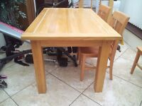Solid oak dinning table and four chairs