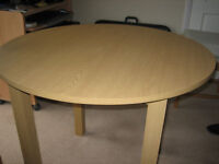 Round light oak vener dinning table. Will dismantle for collection. 90 cm. dia. (35inch.)