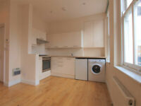 A split level modern with large open plan kitchen property located in the heart on Angel