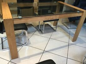 Wooden legs glass top dining table