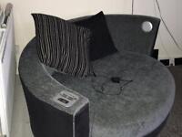 Snuggle sofa with cushions.