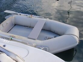 Inflatable dingy 2.3m with snap davits. Can be seen inflated