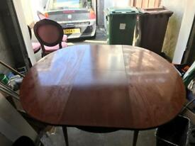 Mahogany expandable table and 4 chairs.