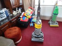 yellow and silver dyson hoover in working order