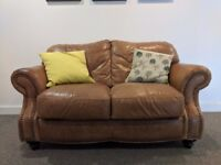Second Hand Two Seater Brown Leather Sofa With Cushions