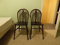Pair of sturdy wheelback wooden chairs. £20 the pair. No offers. Not sold singly.