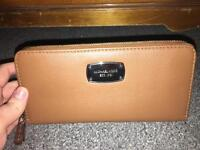 Michael Kors purse. Genuine and never been used.