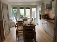Light oak engineered wooden floor in excellent condition approx 35 - 40 sq m