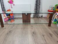 """TV stand with walnut finish suitable for TVs up to 65"""""""