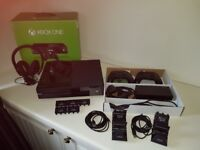 Xbox One.. 2 controllers.. 3 headsets.. chargers.. Boxed