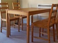 Ikea solid pine table and 4 matching chairs in good condition