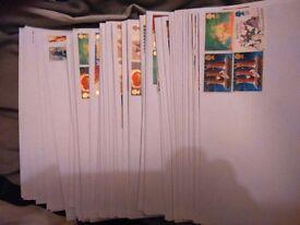 100 unfranked stamps on DL envelopes