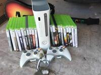 XBox 360 with games and Guitar Hero guitar