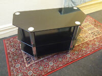 TV Stand (black glass and chrome). Need to sell by Friday 20th