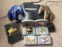 Nintendo 64 console bundle with 2 controllers including rare gold controller and 6 games
