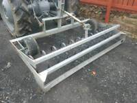 Tractor three point linkage horse arena cultivator with rear levelling bar